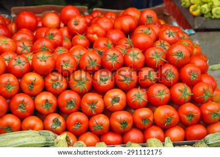 Pile of Red Tomato at Market Stall - stock photo