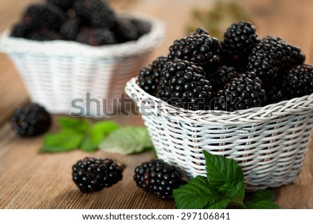 Pile of ripe blackberry in white basket - stock photo