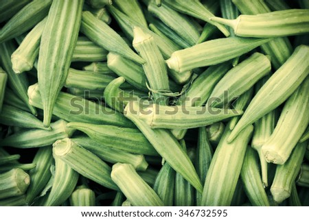Pile of ripe okra for sale at local farmers market - stock photo