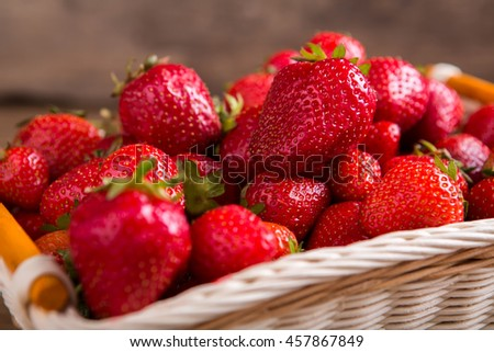 Pile of ripe strawberries. Berries in a basket. Ingredient of fruit pie. Fresh from the garden. - stock photo