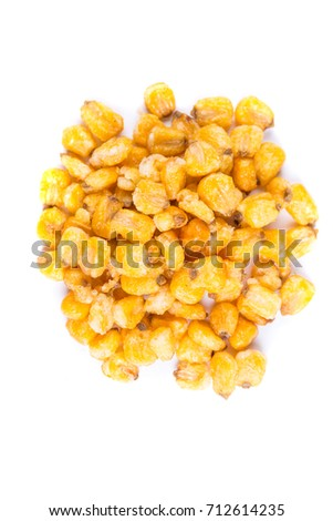 Pile of roasted spiced corn kernels isolated on a white background