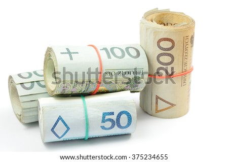 Pile of rolls of Polish banknotes (Polish zloty, PLN) of various denominations tied with rubber bands isolated on white background. - stock photo