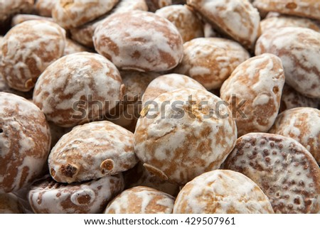 Pile of round gingerbread small cakes with sugar powder - stock photo