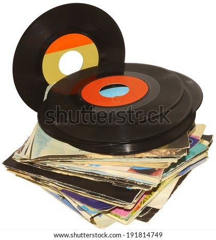 pile of 45 RPM vinyl records used and dirty even - stock photo