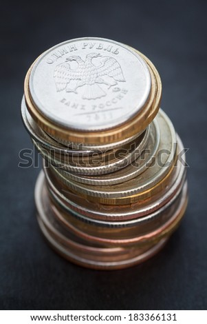 Pile of russian coins on a dark background. Selective focus with shallow depth of field.