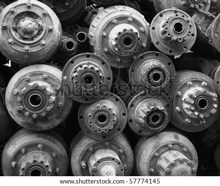 Pile of Rust Old Axles in a Scrap Yard in Black and White - stock photo
