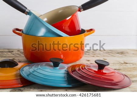 Pile of saucepans and pots - stock photo
