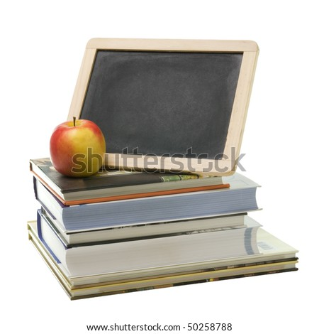 pile of school books, slate and red apple - stock photo