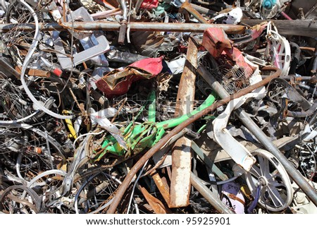Pile of scrap metal background - stock photo