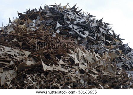 Pile of scrap metal for recycling purposes. - stock photo