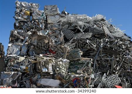 Pile of scrap metal in a scrapyard - stock photo