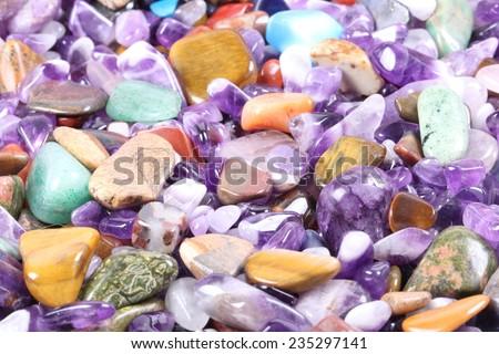 pile of semi precious jewelery stones closeup - stock photo