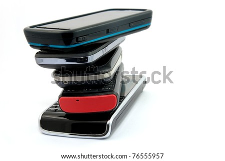 Pile of Several Modern Mobile Phones  Isolated on White Background - stock photo