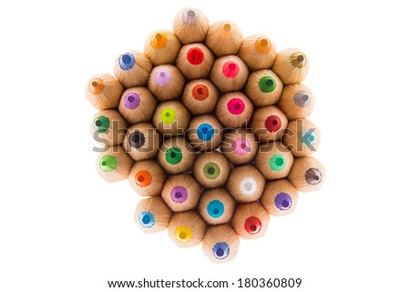 Pile of sharp wooden colored pencils, symbol of creativity, isolated on white background, shot from above - stock photo