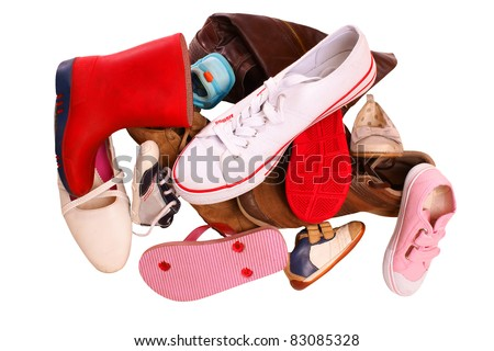 Pile of shoes, isolated against background - stock photo