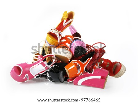 pile of shoes on white background - stock photo