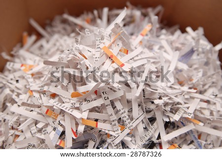 Pile of shredded paper with business words showing.Security content. - stock photo