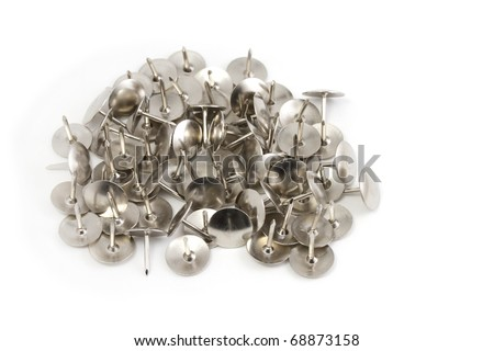 Pile of silver drawing pins on white background