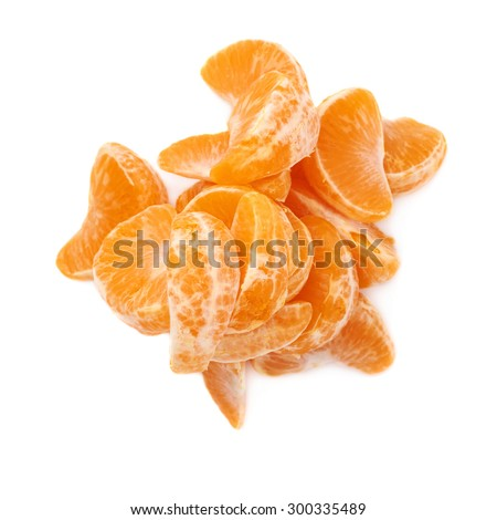 Pile of slice sections of fresh tangerine isolated over the white background
