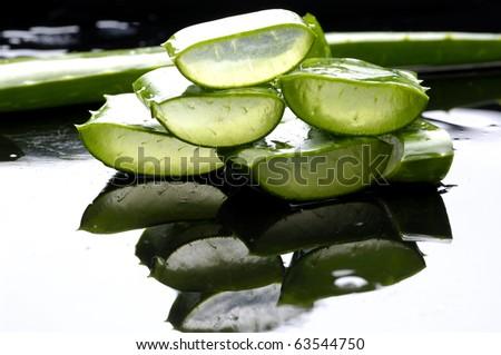 Pile of slice sloe plant with reflection - stock photo