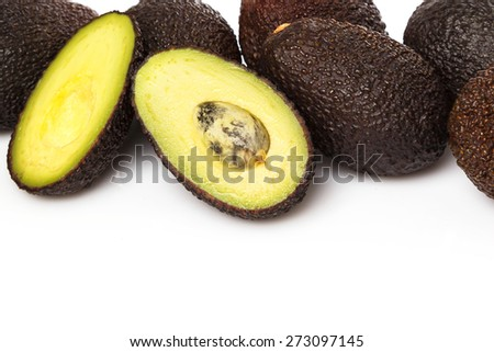 Pile of small avocados on white background