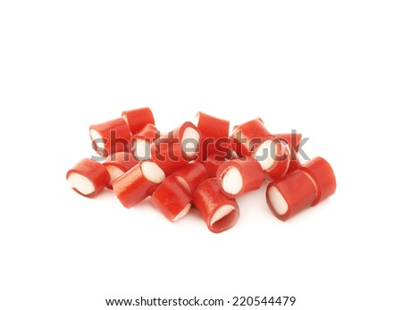 Pile of small red and white candy sweets isolated over the white background