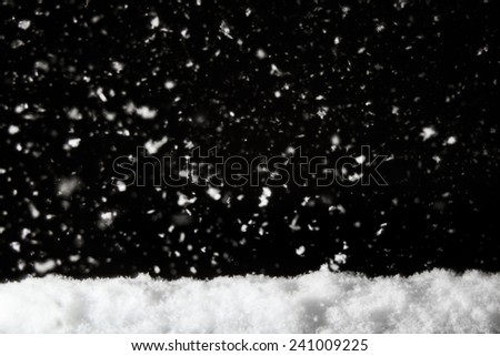 pile of snow with snowing background ,minimalistic - stock photo