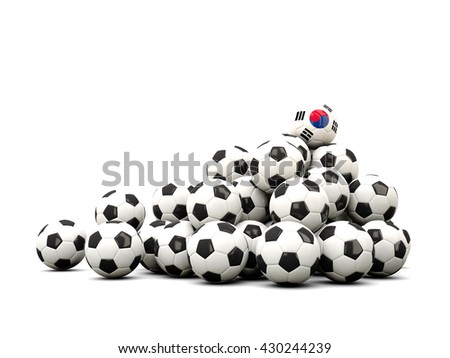 Pile of soccer balls with flag of korea south. 3D illustration - stock photo