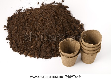 pile of soil and peat pots for seedlings - stock photo