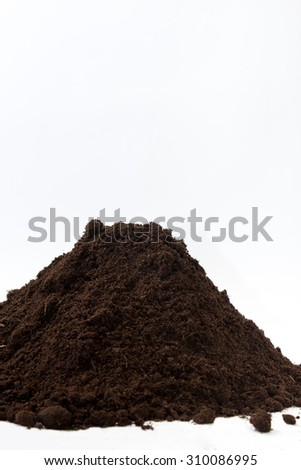 Pile of soil on the left side of the image.