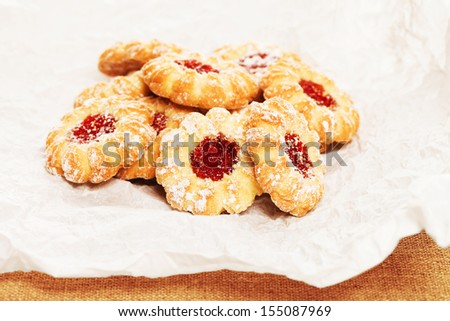 pile of some christmas cookies with jam on a parchment paper - stock photo