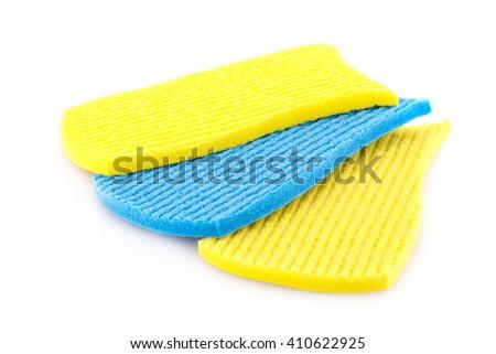 Pile of sponges isolated on white background. - stock photo