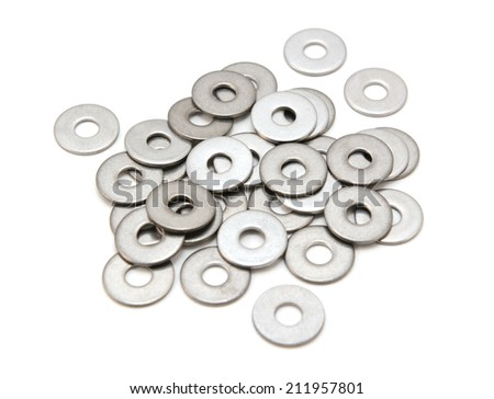 Pile of stainless steel flat washers, isolated on a white background - stock photo