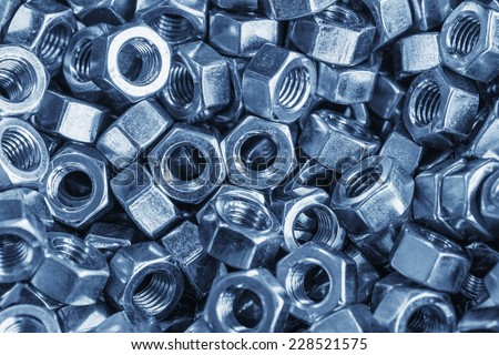 Pile of stainless steel screw-nut - stock photo