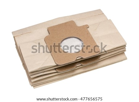 Pile of standard dust paper bags for the electric vacuum cleaner. Isolated on white