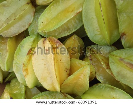 pile of Starfruit on sell at farmers market in Oahu