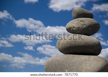 pile of stones against a blue sky background