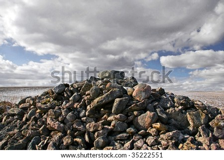 pile of stones against a cloudy sky - stock photo