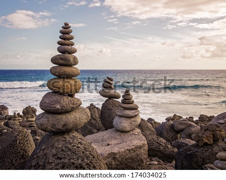 Pile of stones in front of the sea, la Reunion island - stock photo