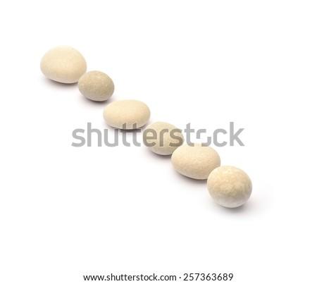 Pile of stones on white background - stock photo