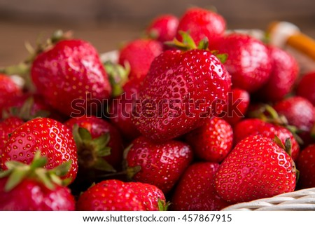Pile of strawberries. Ripe red berries. Ingredient for vegetarian pastry. Sweet and juicy. - stock photo