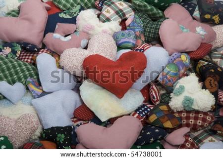 Pile of stuffed fabric hearts - stock photo