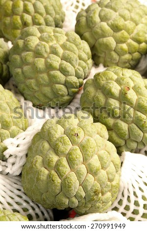 Pile of  sugar apples for sale at market - stock photo