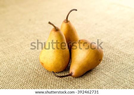 Pile of sweet juicy bosc pears - stock photo
