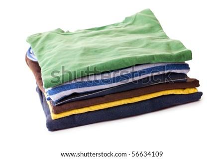 pile of t-shirts on white background - stock photo