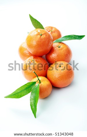 pile of tangerines on white background - fruits
