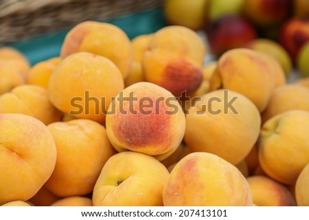 Pile of tasty, orange peaches at a market on the island of Maderia - stock photo