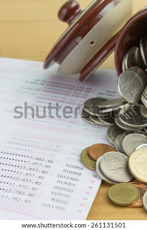 pile of Thai coins and passbook - stock photo