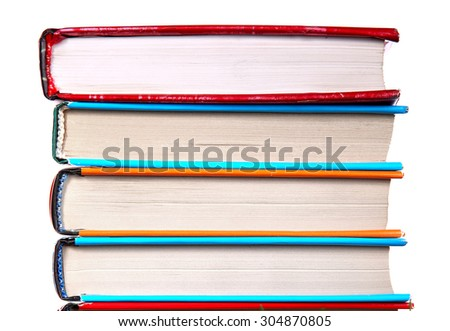Pile of the Books Isolated on the White Background Closeup - stock photo