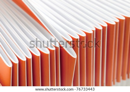 Pile of thin writing-books at a short distance - stock photo